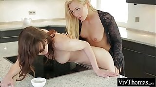 Lesbians having enduring orgasms in the kitchen with their morning espresso